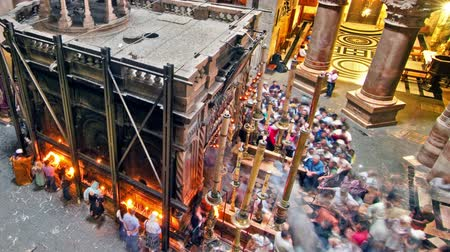 sepulcher : Time lapse of crowds visiting the Aedicule of the Church of the Holy Sepulchre. Panning shot.