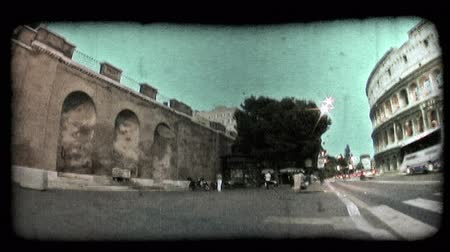 oblouky : Low-angle footage of an arched wall in Rome, Italy as shot on a sidewalk near the Colosseum. Vintage stylized video clip.