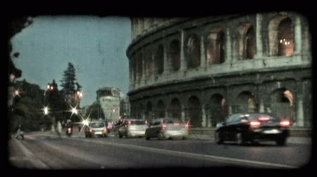 part of clip : Shot of the lower part of the Colosseum as cars pass by. Vintage stylized video clip.
