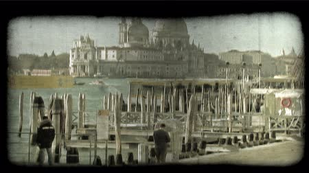 distante : Distant shot of a religious building over a pier in Italy. Vintage stylized video clip.