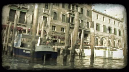 minério : Pan of scenery from a boat down an Italian River. Vintage stylized video clip.