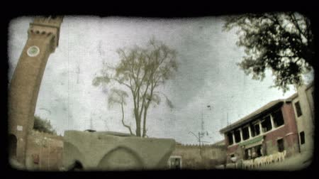 minério : Pan of building surrounding an Italian square. Vintage stylized video clip. Vídeos