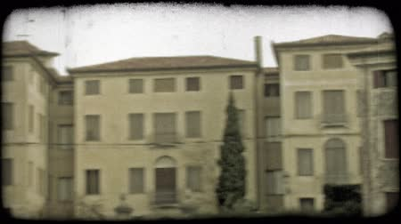 minério : Pan left shot of the rooftops of an Italian city. Vintage stylized video clip.