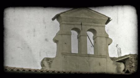 minério : Shot of a religious structure on top of a building in Italy. Vintage stylized video clip.