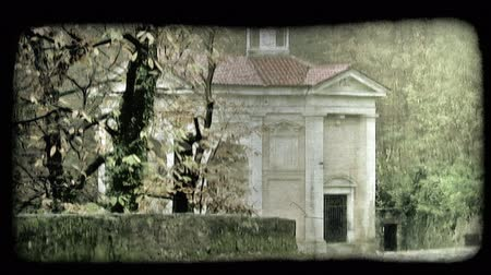 minério : A building sits in the foest on a cloudy da in Italy. Vintage stylized video clip. Vídeos