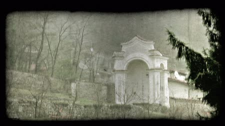 minério : Shot of a village in a rainstorm in Italy. Vintage stylized video clip.