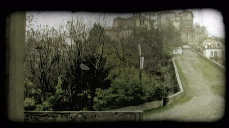 minério : Shot of a steep hill with a small town at the top. Vintage stylized video clip.