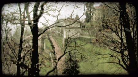 minério : A building sits in the forest. Vintage stylized video clip.