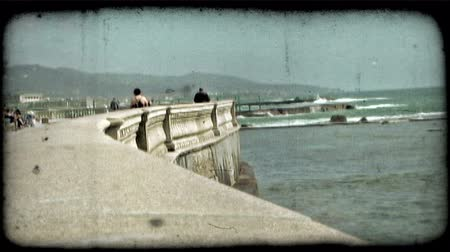 parede : Waves crash on rocks in Italy. Vintage stylized video clip. Vídeos