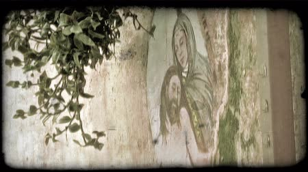 vallási : A lock sown shot of a mural of Christ. Vintage stylized video clip.
