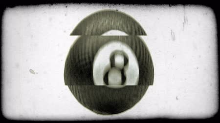 um objeto : A big, black, bouncy ball with an eight printed on it is dropped into frame. Vintage stylized video clip. Stock Footage