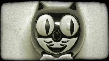 kavramsal : Close-up shot of a Felix the Cat clock. Vintage stylized video clip. Stok Video