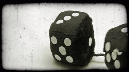 číslo : Shot of two black dice rolling on the floor. Vintage stylized video clip.