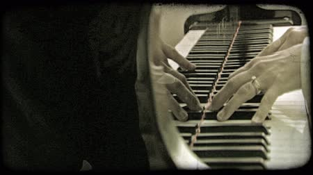 пианино : Static shot of hands playing the piano. Vintage stylized video clip.