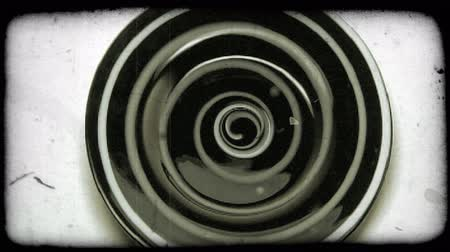 hidromassagem : Zooming in shot of an object with a swirling design. Vintage stylized video clip.