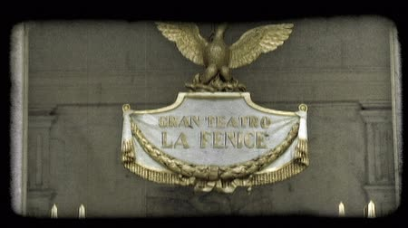 sütun : A shot of the golden sign on the front of an Italian Theater.  The sign says Gran Teatro la Fenice. Vintage stylized video clip. Stok Video