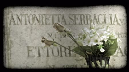 gravestone : A shot of Italian tombstones. Vintage stylized video clip.