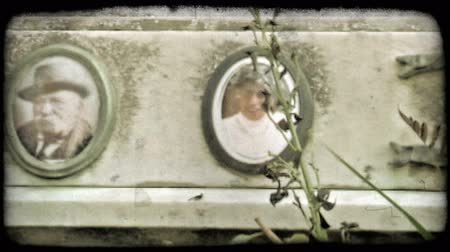 gravestone : A pan left of an Italian tombstone. Vintage stylized video clip.