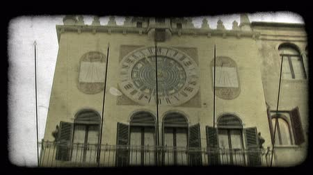 yirmi : Shot of a 24 hour analog clock in Italy. Vintage stylized video clip.