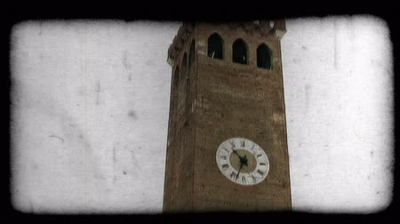 dolgok : Shot of a clock tower in Italy. Vintage stylized video clip. Stock mozgókép