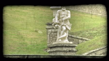 dolgok : Shot of a statue of a man wrestling with a serpent of some kind. Vintage stylized video clip. Stock mozgókép