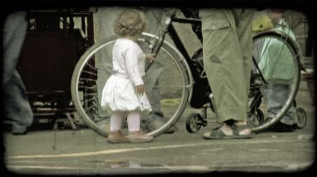 rowerek : A little Italian girl plays with a mans bike tire. Vintage stylized video clip. Wideo