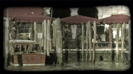 loja : Pan left shot of people walking on a pier in Italy. Vintage stylized video clip.