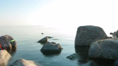 к северу : Sunny day time-lapse looking arcross the Sea of Galilee. Panning shot.