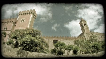 dolgok : Time-lapse clouds behind an Italian castle shot with a wide angle lens. Vintage stylized video clip.
