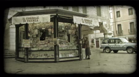 gazete : Time Lapse shot of a news stand in Italy. Vintage stylized video clip.