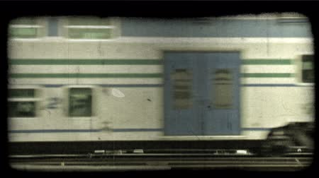 dolgok : Shot of a couple passing trains in Italy. Vintage stylized video clip.