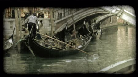 motor vehicle : Shot of a gondolier, with his gondola. Vintage stylized video clip. Stock Footage