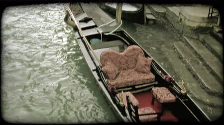 minério : Shot of a gondola tied to a dock. Vintage stylized video clip.