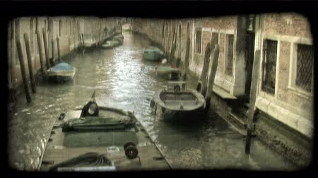 motor vehicle : Motor boat running in the water,and tied up to dock. Vintage stylized video clip.
