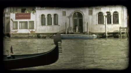 dolgok : Shot of a gondola moving through the water in Venice. Vintage stylized video clip.