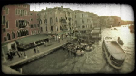 dolgok : A sunset shot of boats and gondolas in a Venice canal. Vintage stylized video clip.