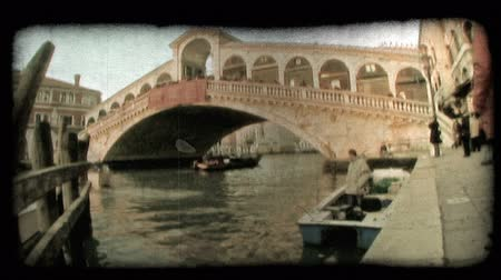 motor vehicle : A shot of a bridge over a Venice canal. Vintage stylized video clip.