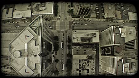 curvature : Wide-angle aerial shot of downtown Salt Lake City from directly above, as tall buildings reach up and car-filled streets follow curvature of the earth. Vintage stylized video clip.