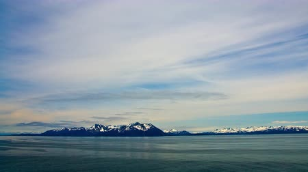 alpes : Traveling time-lapse from a cruise ship in the expansive Prince William Sound,Alaska. The foreground is constituted of the sea and mountains are seen in the background together with the sky