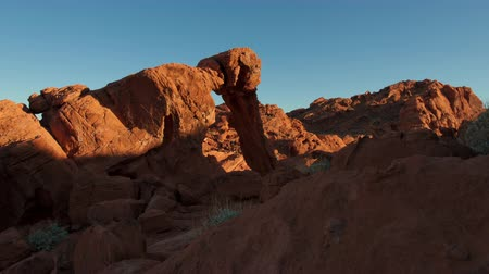 rocks red : Timelapse shot of Elephant Rock during sunset at Nevadas Valley of Fire State Park