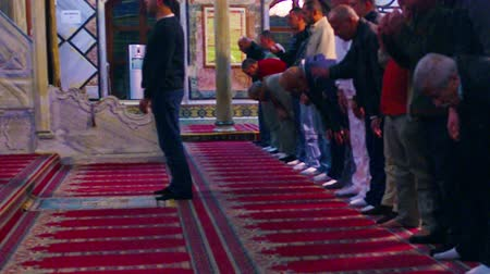 akko : Men praying in a Mosque at Akko, Isreal. Standing and then bowing, heads to the floor. Shot with the Red One digital camera at 4k 4096 x 2304 resolution. 02192011.