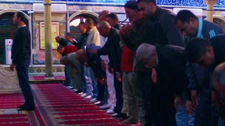 modlitba : Men praying in a Mosque at Akko, Isreal. Standing and then bowing, heads to the floor. Shot with the Red One digital camera at 4k 4096 x 2304 resolution. 02192011.