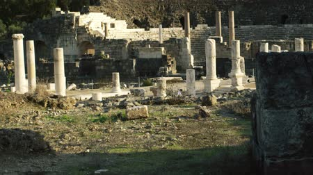 római : Dolly shot of ruins from the Roman and Hellenistic occupation in Beit Shean, Israel. The colonnaded Palladius street and the theater can be seen in the background. Shot with the Red One digital camera at 4k 4096 x 2304 resolution. 02232011 Stock mozgókép