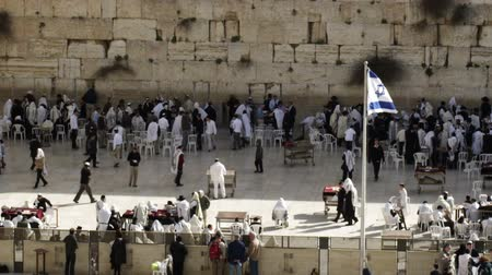 wailing : Wide shot of the Western Wall Wailing Wall of the Temple Mount showing both the male and female sections. In the city of Jerusalem, Israel. Shot with the Red One digital camera at 4k 4096 x 2304 resolution. 02262011