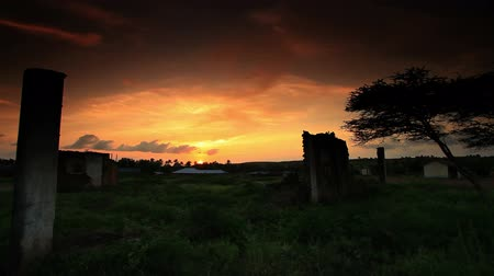 falu : Ruins of African village at sunset Stock mozgókép