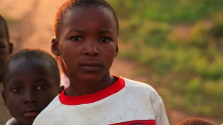 deprived : Boys look at camera in Africa