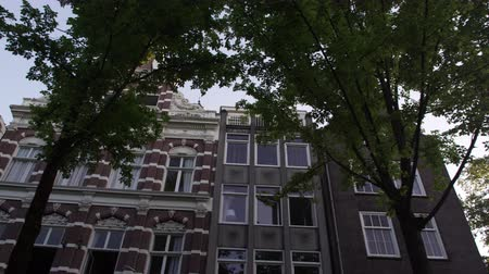cegła : Shot of a beautiful ancient building on a street in Amsterdam. This was taken in the afternoon while the videographer was aboard a boat