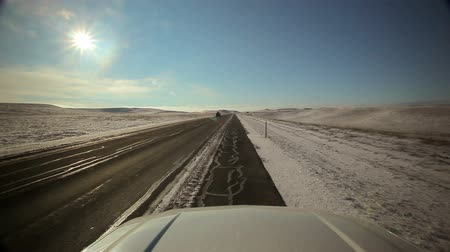 straight road : Stationary view of the freeway in Wyoming during the winter from a parked car off to the side of the road.