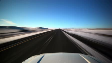 straight road : Traveling view of the freeway in Wyoming during the winter, showing big empty fields off to both sides. Stock Footage