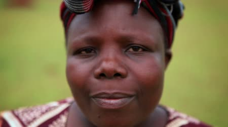 kapatmak : Headshot of an adult woman smiling slightly at the camera. She wears a head scarf. Filmed in Kenya, Africa.